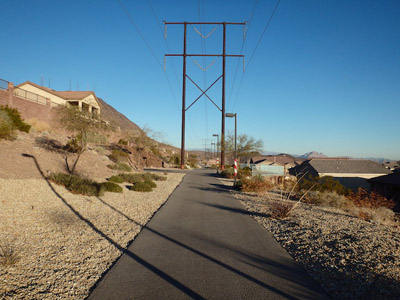 Paved trail under power lines.